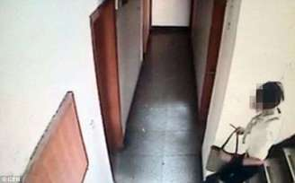 Zhang caught on camera inside the hotel where she chopped off part of Liu's manhood. (Photo Credit: CEN)