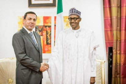 The Head of Mission, Syrian embassy in Nigeria, Dr. Shafik Daiyob  shakes hands with with president-elect Muhammadu Buhari during a visit on to the Aso Rock on Monday, May 11, 2015