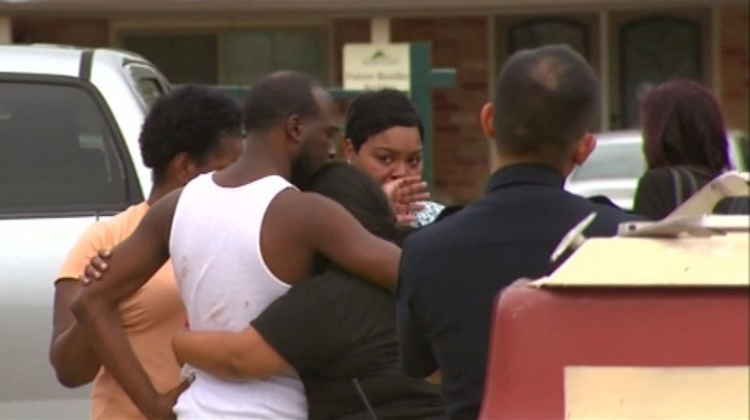 Friends and family gathered around the home of Deleon Alonso Smith, 19, who shot himself dead while trying to take selfie with a loaded gun in Texas. (Photo Credit: NBC)