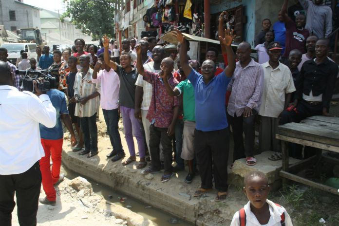 Crowds cheering Governor Nyesom Wike as he inspects road projects in Port Harcourt | Rivers Gov't Photo