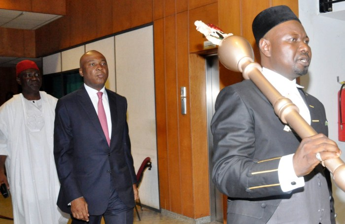 Senate President Bukola Saraki (m) going in for his first plenary session at the Senate Chamber in Abuja, Wednesday, June 10, 2015. Behind him is the deputy senate President, Ike Ekweremadu | NAN Photo