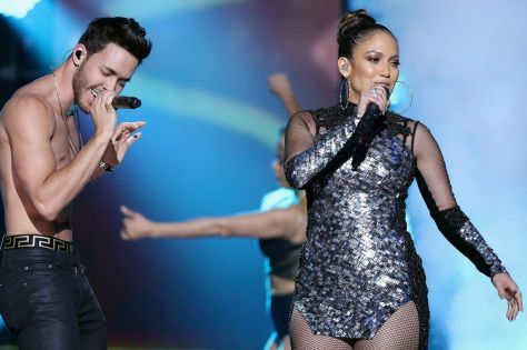 Prince Royce and Jennifer Lopez performs onstage at iHeartRadio Fiesta Latina at American Airlines Arena on November 7, 2015 in Miami, Florida | Splash