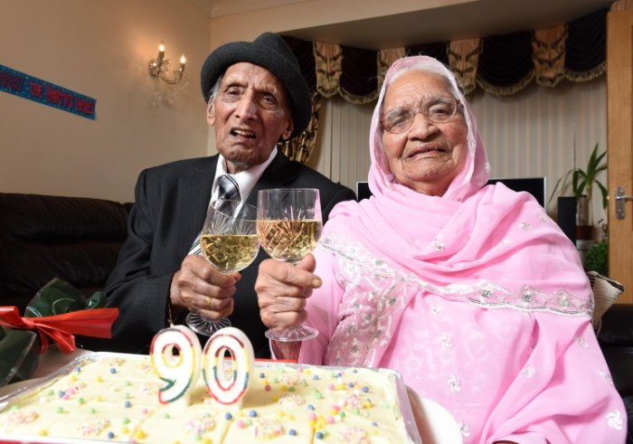 Karam (left) and Karaari Chand, aged 110 and 103 respectively, celebrate their 90th wedding anniversary at home in Bradford.