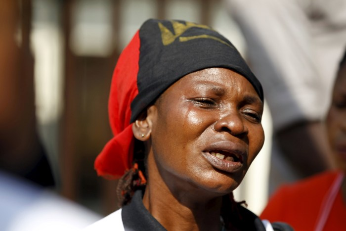A Biafra supporter cries during a rally in support of Nnamdi Kanu in Abuja, December 1, 2015. Dutch lawyers have filed a case against Nigerian President Muhammadu Buhari for alleged crimes against humanity against pro-Biafran activists.   Afolabi Sotunde/Reuters