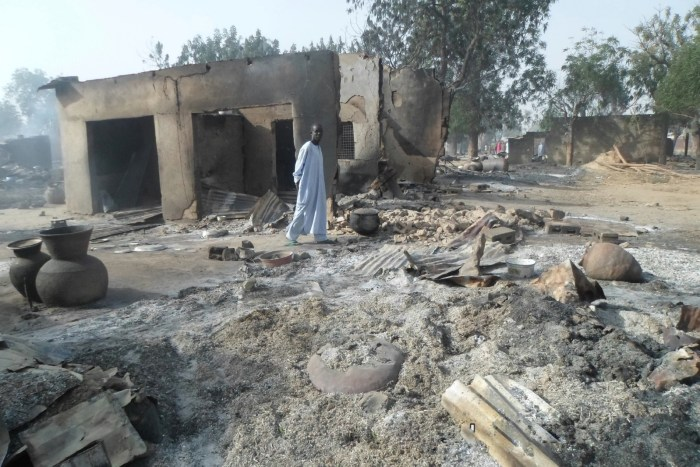 A man walks past burnt out houses following an attack by Boko Haram in Dalori village 5 kilometers (3 miles) from Maiduguri, Nigeria, Sunday Jan. 31, 2016.   AP/Jossy Ola