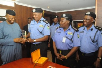 Governor Segun Mimiko Receiving a Gift from IGP Solomon Arase during a Courtesy Call by the IGP on Friday, February 12, 2016 | Ondo TV