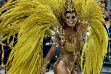 TOPSHOT - Revellers of Uniao da Ilha samba school perform during the first night of the carnival parade at Sambadrome in Rio de Janeiro, Brazil on February 7, 2016. AFP PHOTO / YASUYOSHI CHIBA / AFP / YASUYOSHI CHIBAYASUYOSHI CHIBA/AFP/Getty Images