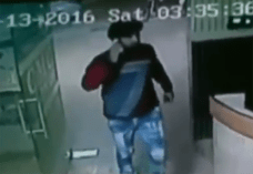 The man can be seen walking through the hospital talking on the phone (Picture: Haryana Police)