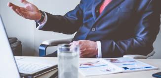 office man suit laptop desk