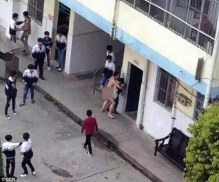 Photos have emerged of a naked man trying to rape a student at a high school in Guangxi, China on Monday, March 28, 2016   CEN