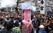 People crowd outside the Wakamiya Hachimangu Shrine to see portable shrines bearing phalluses during the Kanamara Festival in Kawasaki, a suburb of Tokyo on Sunday, April 3, 2016.