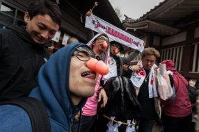 Japanese men wearing joke glasses with penis nose pieces during the Kanamara Matsuri (Festival of the Steel Phallus) on Sunday, April 3, 2016 in Kanagawa, Japan.