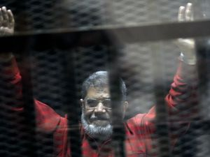 Mohammed Morsi is pictured in a defendant's cell in an Egyptian court | Ahmed Omar/AP