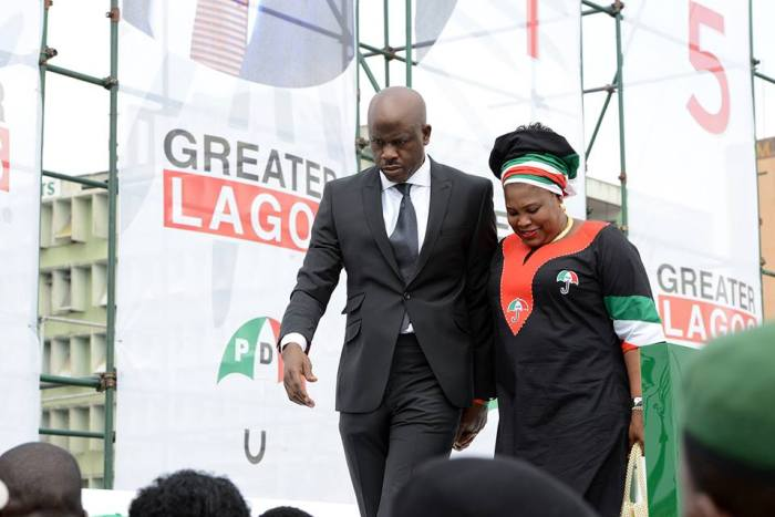 Senator Musiliu Obanikoro pictured with his wife, Moroophat at a 2014 PDP campaign event in Lagos, Nigeria