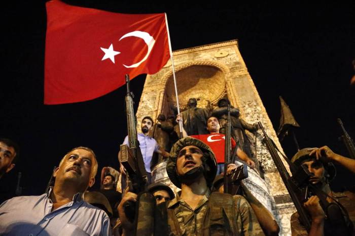 Soldiers loyal to the government of Turkey stand with citizens resisting the coup attempt of Friday, July 15, 2016 | Business Pundict