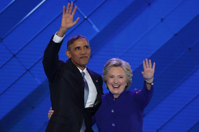 US President Barack Obama and Democratic Presidential nominee Hillary Clinton embrace on the third day of the Democratic National Convention at the Wells Fargo Center, July 27, 2016 in Philadelphia, Pennsylvania. | Alex Wong/Getty Images