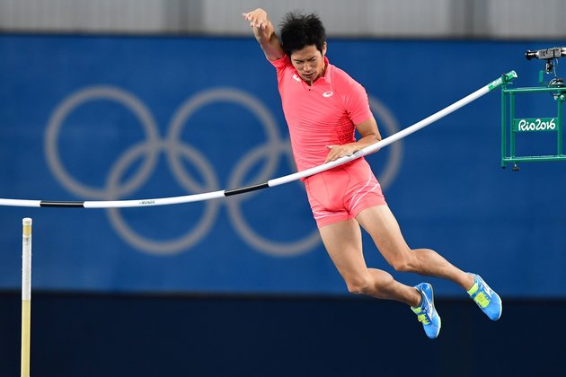 Japan's Hiroki Ogita competes in the Men's Pole Vault Qualifying Round during the athletics event at the Rio 2016 Olympic Games at the Olympic Stadium in Rio de Janeiro on August 13, 2016. | AFP/Franck Fife/Getty Images