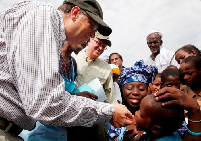 Billionaire philanthropist , Bill Gates administering polio vaccines to children in Northern Nigeria