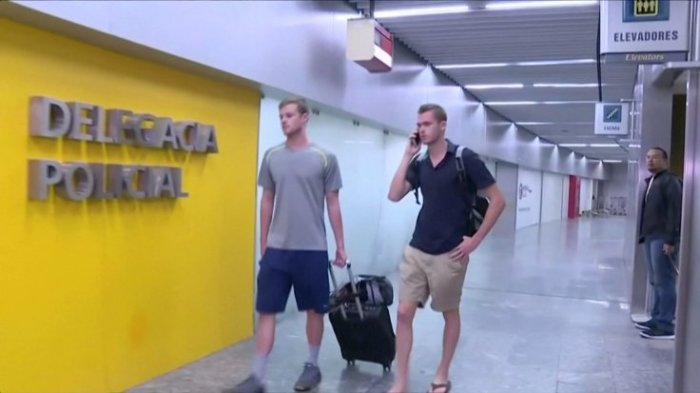 US Olympic swimmers Gunnar Bentz and Jack Conger walk to the airport police station office at Rio's international airport in this still frame taken from video dated August 17, 2016, in Rio De Janeiro, Brazil. | GLOBO TV/via REUTERS TV