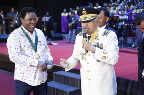 The President of the Generals, Admirals and the Officers of the Armed Forces of Peru, General Juan Gonzalez Sandoval, bestows a military decoration upon T.B. Joshua. | PRNewsFoto/Emmanuel TV