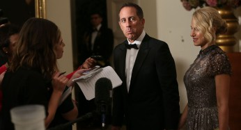 Comedian Jerry Seinfeld and his wife, Jessica Seinfeld, speak to members of the media as they arrive at the State Dinner.   Getty