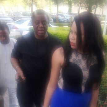 Chief Fani-Kayode (in black) walks behind his wife, Precious Chikwendu at the premises of the federal high court in Abuja