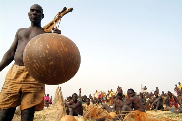 George Osodi took his lenses to the Argungu Fishing Festival. A man is pictured with a fish pot | The New Gong