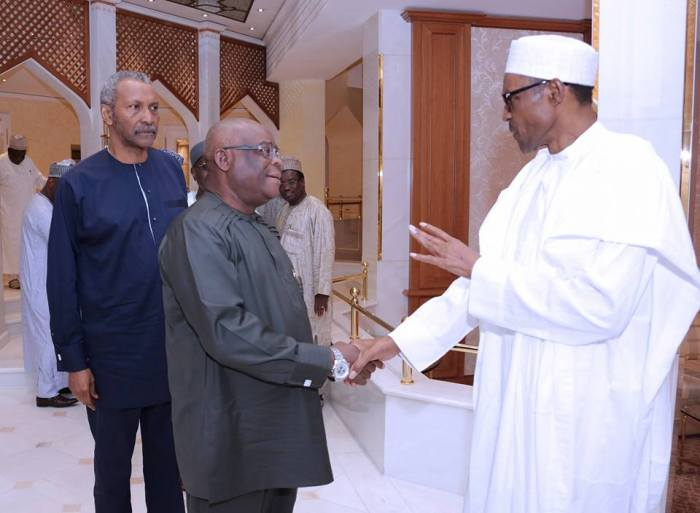 Supreme Court Justice Walter Onnoghen greets President Muhammadu Buhari when he hosted members of the judiciary in Aso Rock
