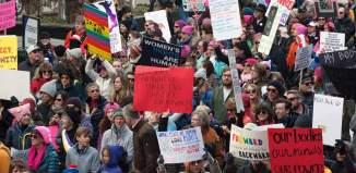 women protest anti-trump in denver