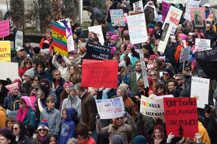 women protest anti-trump in denver