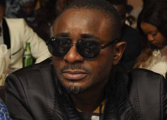 Nollywood actor, Emeka Ike pictured with his wife, now ex, and daughter