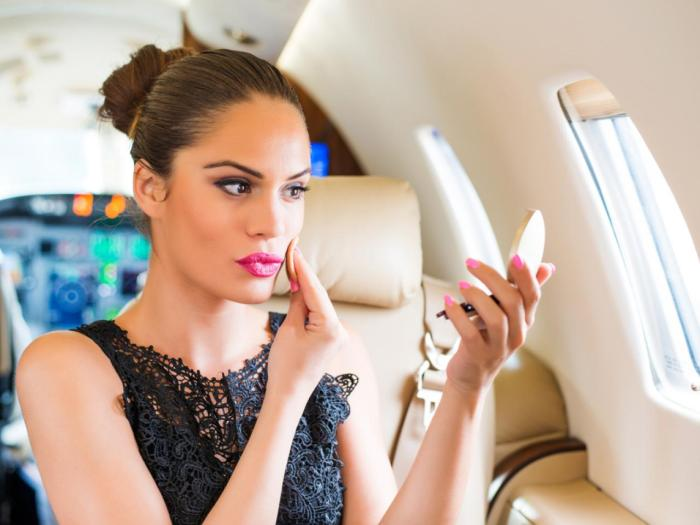 d59fd74332d2 make up airport airplane travel woman