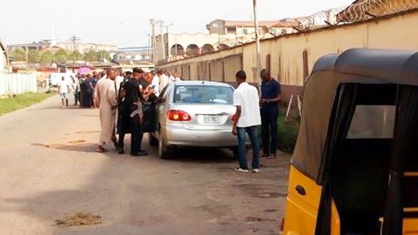 Policemen and sypathisers at the scene of the tragedy, on Sunday at Ogba, Lagos.