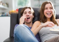 alternatives to Netflix Young couple watching TV love