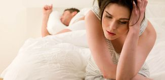 unhappy couple on bed cheat