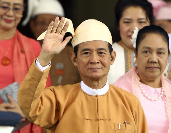 Myanmar's new President Win Myint waves to the media after taking oath of office at Parliament in Naypyitaw, Myanmar, Friday, March 30, 2018. Myanmar sworn the longtime Aung San Suu Kyi loyalist as the country's new president, who will continue his predecessor's deference to her as the nation's de facto leader. (AP Photo/Aung Shine Oo)