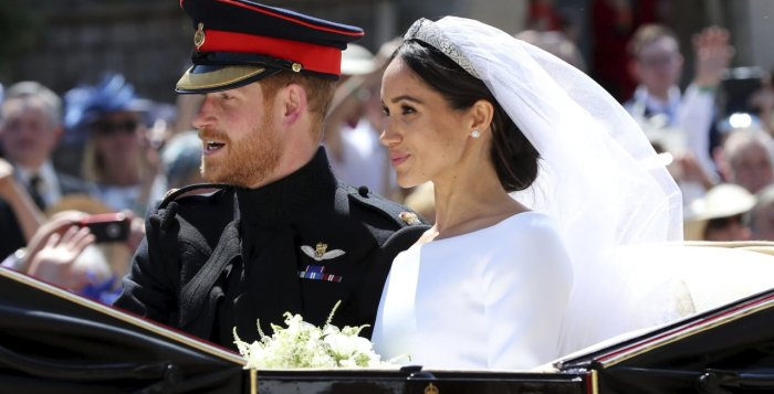 Meghan Markle and Prince Harry leave after their wedding