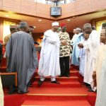 Senate President Bukola Saraki (in front) and Deputy Senate President Ike Ekweremadu enter the Nigerian Senate chamber