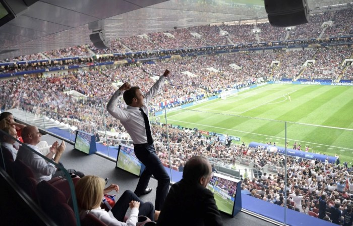 French President Emmanuel Macron (C) reacts to France's victory. AAP
