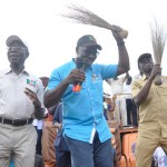 Godwin Obaseki, the candidate of the All Progressives Congress dancing at a campaign rally during his race for governor of Edo State. Beside him (left) is Governor Adams Oshiomhole, his political godfather.