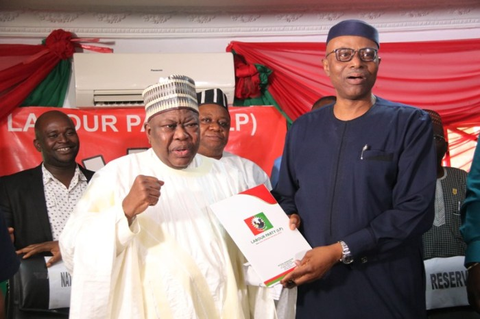 Former Governor of Ondo State/Presidential Aspirant of the LP, Dr Olusegun Mimiko, receiving nomination form from the National Chairman, of Labour Party, Alhaji Abdulkadri Abdulsalam.
