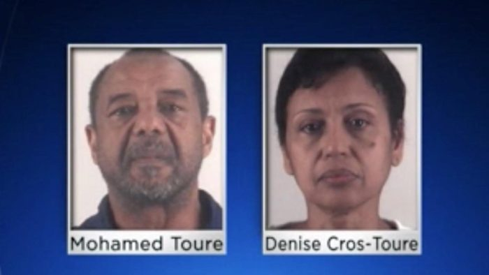 Mohamed Toure and his wife, Denise Cros-Toure, have been indicted on five counts of forced labor and alien harboring. They allegedly enslaved an African girl for more than 16 years. (Image source: Video screenshot)