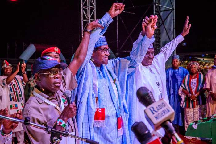 President Buhari with R-L: APC National Chairman Adams Oshiomole and APC National Secretary Maimala Buni as he is declared the Presidential Candidate and Flag bearer of the All Progressives Congress at the APC Presidential National Convention at Eagle Square on 6th Oct 2018
