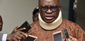 Ayodele Fayose, governor of Ekiti State pictured in a neckbrace following alleged assault by police at the Ekiti Government House in 2018