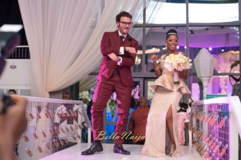 Tosyn Bucknor and her husband dance at their wedding