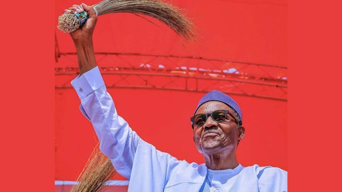 Nigeria's President Muhammadu Buhari waves a broom, the symbol of his party, the All Progressives Congress, APC at a campaign event