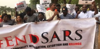 Protesters stage a demonstration against the killings and human rights abuses by the police squad SARS in Nigeria.