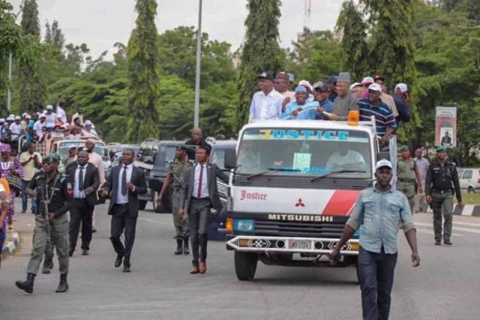 Police teargas PDP leaders, Senate President Bukola Saraki, Senator Ben-Murray Bruce, Senator Dino Melaye, former Jigawa Governor Sule Lamindo, the party chairman, Uche Secondus, Speaker of the House Yakubu Dogara, Governor of Sokoto, Aminu Tambuwal when they staged a protest for a free and fear election at the INEC office in Abuja on October 5, 2018