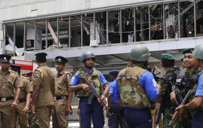 Police and security personnel stand guard outside the Shangri-La Hotel in Sri Lankan capital Colombo following a bombing attack EPA