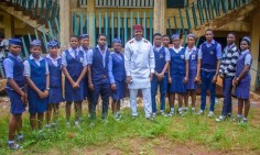 Valentine Ozigbo (middie) takes a picture with the students of his alma mater at the Annual Andrew And Christiana Ozigbo Excellence Awards at Christ The Redeemer College Amesi on Sun Aug 2